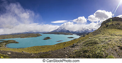 mountains of patagonia at daylight near blue lake from...