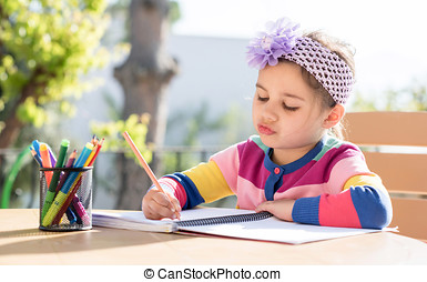 Little Girl Drawing Picture Outdoors In Spring
