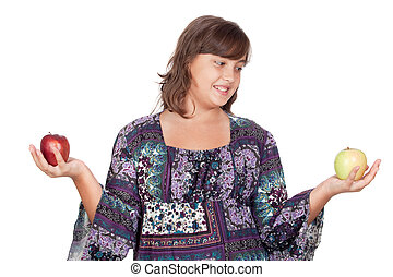 Adorable preteen girl with two differents apples isolated on...