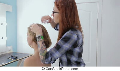 Professional hairdresser, stylist using hair gel -...
