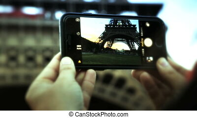Taking a picture of the Eiffel with smartphone - Shot of...