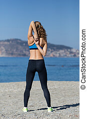 Healthy and fitness lifestyle Young woman stretching on...