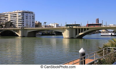 View along the Guadalquiver River in Seville - A View along...