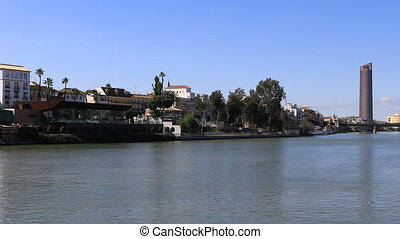 Scene along the Guadalquiver River in Seville - A Scene...