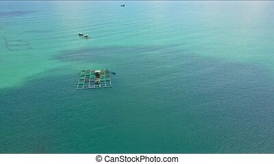 Aerial View Floating Farm among Calm Azure Ocean - aerial...