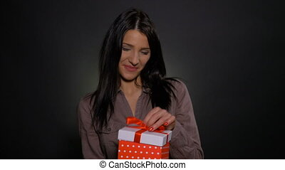 Beautiful woman disappointed when opening gift box