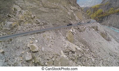 car drives along the rocky road