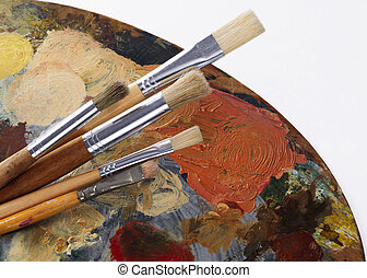 paintbrushes and palette on the white background