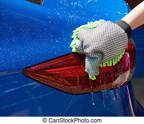 Washing blue car close-up