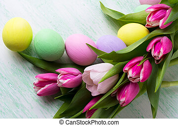 Easter arrangement with purple, pink, green, yellow painted...