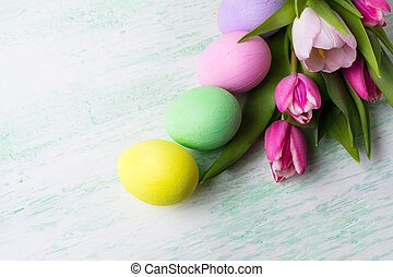 Easter background with purple, pink, green, yellow painted...