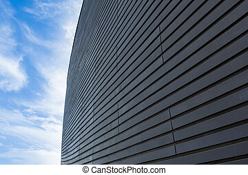 Dark wooden wall diminishing perspective into light cirrus...