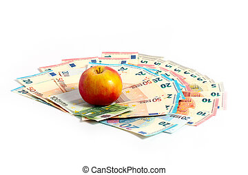 paper currency euro - A beautiful ripe fresh apple lies on a...