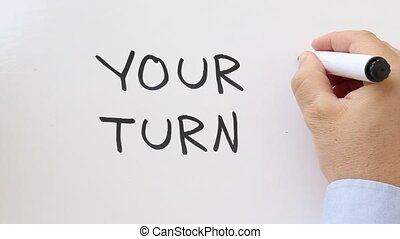 Your turn written on whiteboard - Whiteboard writing...
