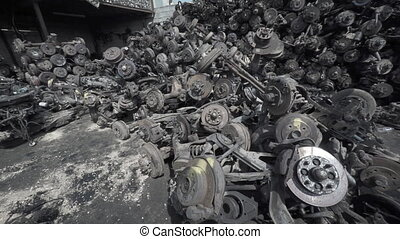 Disorganized Heap of Castoff Car Axles and Wheel Parts -...