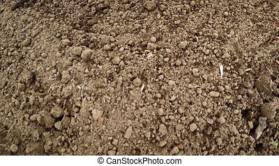 Closeup of Recently Tilled Soil in a Garden - Closeup of...