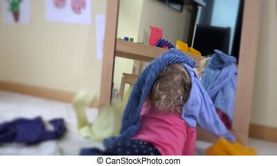 girl with curly blond hair lying near mirror and colorful...