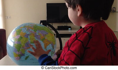 Young boy with globe - Shot of Young boy with globe