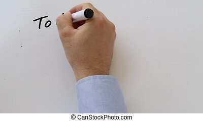 Writing a to do list on whiteboard - Whiteboard writing...