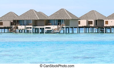 Closeup Zoom of Bungalows over the Water in the Maldives