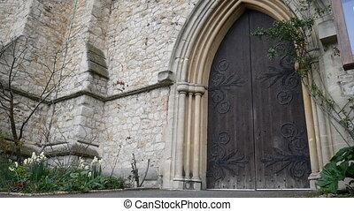 Wooden door of an ancient stone building.