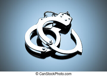 Handcuffs interlocked placed on a reflective tabletop