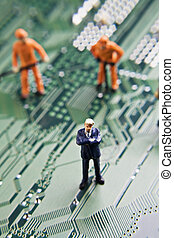 figurines on a circuit board