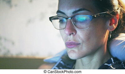 Woman with glasses look at a computer screen - Shot of Woman...