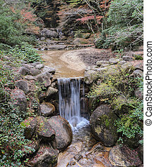 Waterfall in Momijidani Park, Miyajima, Japan - Waterfall...