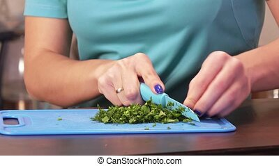 Cutting greens on a cutting board