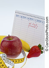 good intent to healthy diet - apple, tape measure and...