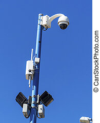 surveillance camera on a wall. video surveillance is an...