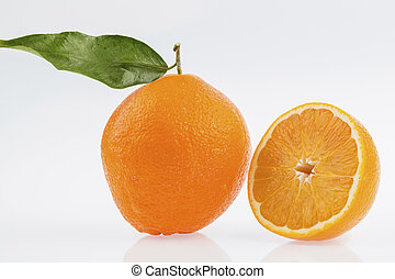 reflection of an orange. symbol photo for healthy vitamins...