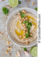 Homemade hummus with olive oil and fresh parsley