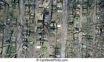 Aerial shot of old cemetery on a sunny spring day, top view....