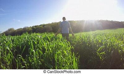 Walking in a green field - Shot of Walking in a green field