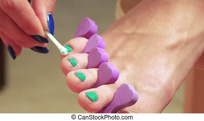 Circumcision of nails on legs - Girl doing a pedicure with...