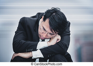 asian businessman sad worry tired and headache, stress at workplace, feeling ill, finance problem and lost job, close up shot background