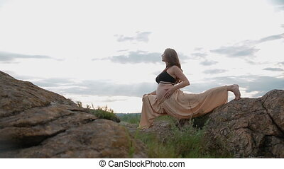 Pregnant woman doing sport outdoors
