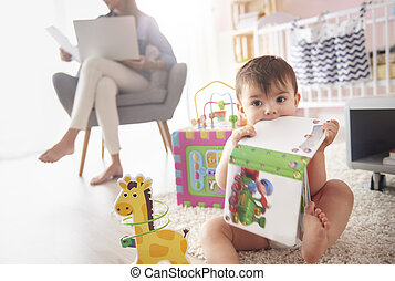 Toddler playing with toys in the room
