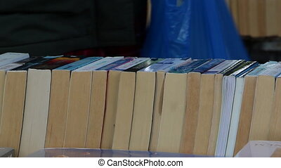 Used books on display in second hand market - Shot of Used...