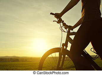 Silhouette of cyclist on bike