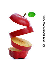 Sliced red apple with green leaf