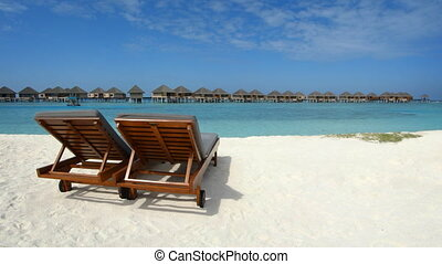 Sun Loungers on a Tropical Beach Paradise in the Maldives -...