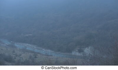 Foggy Panorama of the gorge with the mountain river -...