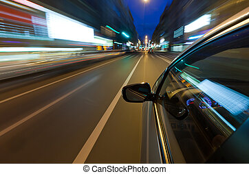 Car driving fast in the night city - Cars driving through...