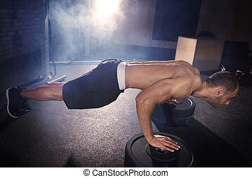Side view of mid adult man in plank position