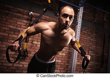 Male athlete working out with resistance bands