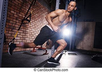 Male athlete doing stretching exercises