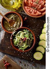 vegan zucchini spaghetti and pesto sauce - high-angle shot...